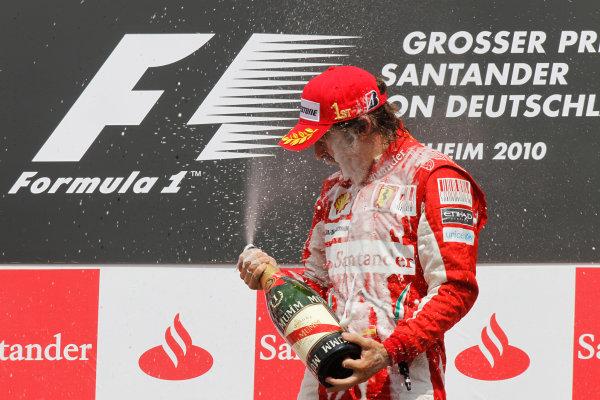 Hockenheimring, Hockenheim, Germany 25th July 2010 Fernando Alonso, Ferrari F10, 1st position, sprays the champagne on the podium. Portrait. Podium.  World Copyright: Andrew Ferraro/LAT Photographic ref: Digital Image _Q0C4579