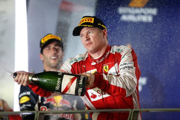 Marina Bay Circuit, Singapore. Sunday 20 September 2015. Kimi Raikkonen, Ferrari, 3rd Position, sprays his Champagne from the podium. World Copyright: Glenn Dunbar/LAT Photographic ref: Digital Image _89P6085