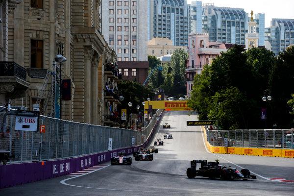 Baku City Circuit, Baku, Azerbaijan. Sunday 19 June 2016. Jenson Button, McLaren MP4-31 Honda, leads Pascal Wehrlein, Manor MRT 05 Mercedes, at the start of the race World Copyright: Sam Bloxham/LAT Photographic ref: Digital Image _SLA3516