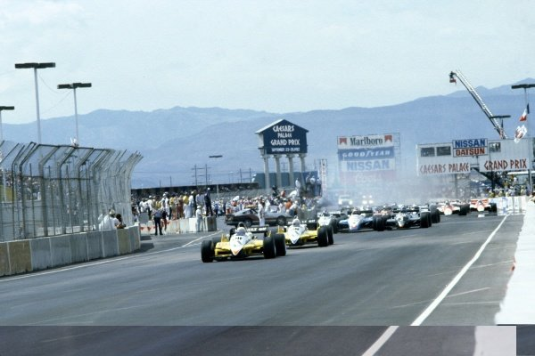 1982 Las Vegas Grand Prix.Caesars Palace, United States. 25 September 1982.Alain Prost, Renault RE30B, 4th position, leads Rene Arnoux, Renault RE30B, retired, at the start, action.World Copyright: LAT PhotographicRef: 35mm transparency 82LV06