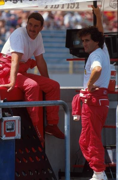 Ferrari team mates Nigel Mansell and Alain Prost talk on the pit wall. German GP, Hockenheim, Germany, 29 July 1990
