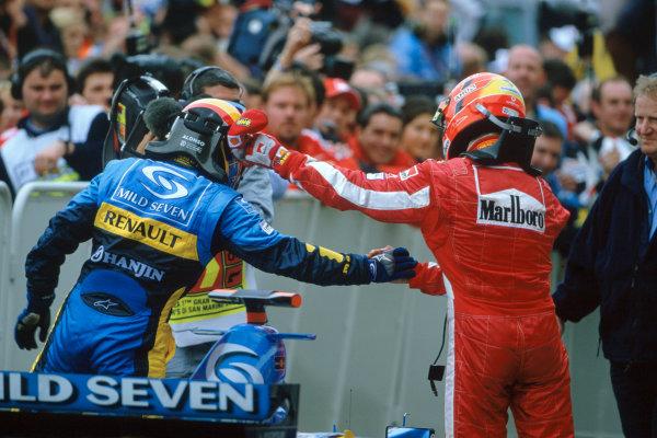 2005 San Marino Grand Prix.Imola, Italy. 24th April 2005.Fernando Alonso, Renault R25 celebrates and Michael Schumacher, Ferrari F2005.World Copyright: LAT PhotographicRef-05SanMarino 36