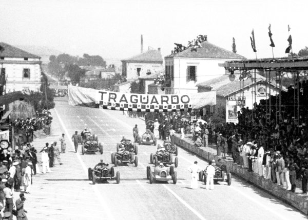 "1935 Coppa Acerbo Pescara, Italy. 15 August 1935 Moments before the start, front row from left-to-right: Tazio Nuvolari, Alfa Romeo Tipo-B ""P3"", retired, Achille Varzi, Auto Union B, 1st position, and Louis Chiron, Alfa Romeo Tipo-B ""P3"", 6th position, are followed by Antonio Brivio, Alfa Romeo Tipo-B ""P3"", 3rd position, Mario Tadini, Alfa Romeo Tipo-B ""P3"", 5th position, Piero Dusio, Maserati 8CM, retired, Carlo Maria Pintacuda, Alfa Romeo Tipo-B ""P3"", retired, Gianfranco Comotti, Alfa Romeo Tipo-B ""P3"", 4th position, Bernd Rosemeyer, Auto Union B, 2nd position, and Luigi Soffietti, Maserati 8CM, retired, action World Copyright: Robert Fellowes/LAT PhotographicRef: 35CA08"