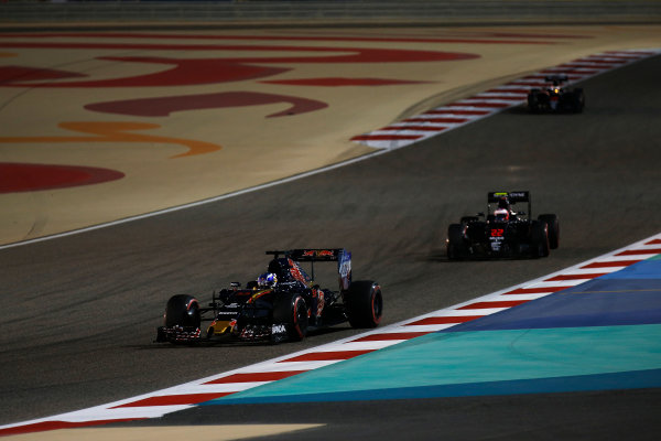 Bahrain International Circuit, Sakhir, Bahrain. Sunday 3 April 2016. Max Verstappen, Toro Rosso STR11 Ferrari leads Jenson Button, McLaren MP4-31 Honda. World Copyright: Sam Bloxham/LAT Photographic ref: Digital Image _R6T6834