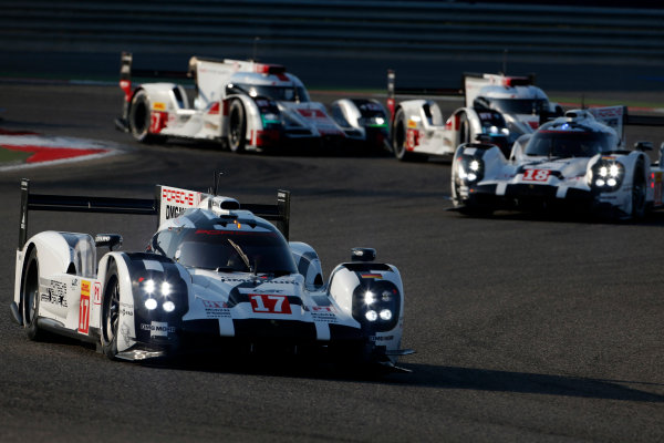 2015 FIA World Endurance Championship Bahrain 6-Hours Bahrain International Circuit, Bahrain Saturday 21 November 2015. Timo Bernhard, Mark Webber, Brendon Hartley (#17 LMP1 Porsche AG Porsche 919 Hybrid) leads Romain Dumas, Neel Jani, Marc Lieb (#18 LMP1 Porsche AG Porsche 919 Hybrid), Lucas Di Grassi, Lo?c Duval, Oliver Jarvis (#8 LMP1 Audi Sport Team Joest Audi R18 e-tron quattro) and Marcel F?ssler, Andr? Lotterer, Beno?t Tr?luyer (#7 LMP1 Audi Sport Team Joest Audi R18 e-tron quattro). World Copyright: Alastair Staley/LAT Photographic ref: Digital Image _79P0123