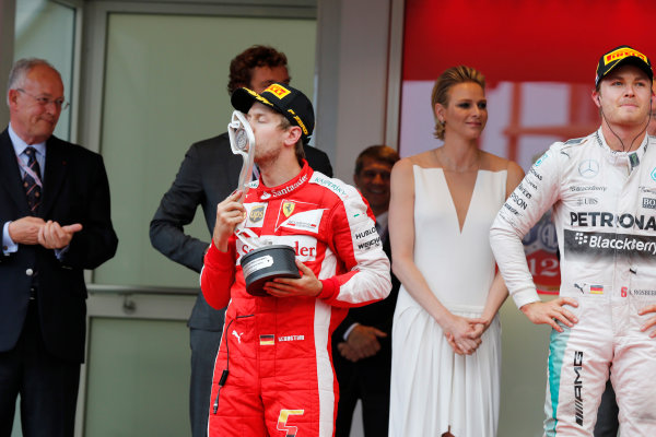 Monte Carlo, Monaco. Sunday 24 May 2015. Sebastian Vettel, Ferrari, 2nd Position, kisses his trophy on the podium. World Copyright: Steven Tee/LAT Photographic. ref: Digital Image _L4R3206