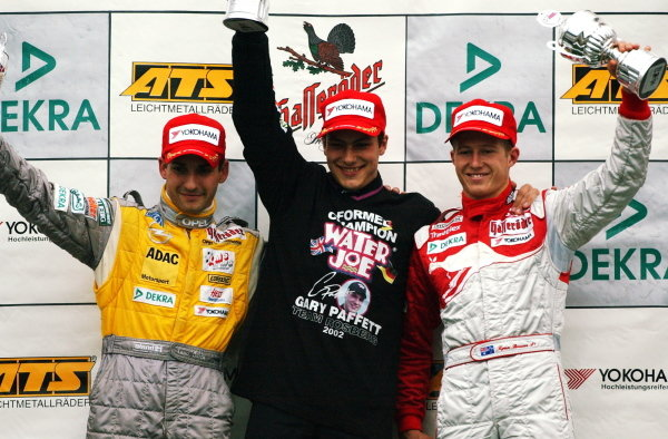 Podium of the Saturday race. Winner and 2002 champion: Gary Paffett (GBR), Team Rosberg, centre; 2nd: Timo Glock (GER) Opel Team KMS, left; 3rd: Ryan Briscoe (AUS), Prema Powerteam, right.