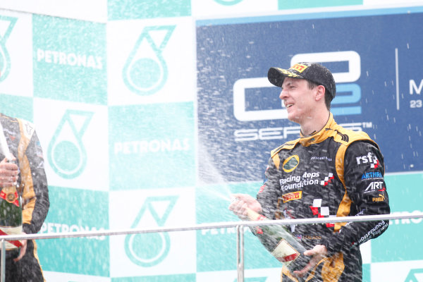 Sepang, Kuala Lumpur, Malaysia. 25th March 2012. Sunday Race.James Calado (GBR, Lotus GP) celebrates his victory on the podium. World Copyright: Alastair Staley/GP2 Series Media Service.Ref: Digital Image AS5D7699.jpg