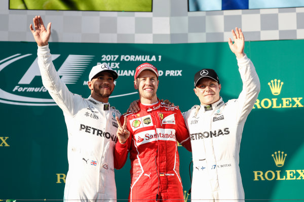Albert Park, Melbourne, Australia. Sunday 26 March 2017. Lewis Hamilton, Mercedes AMG, 2nd Position, Sebastian Vettel, Ferrari, 1st Position, and Valtteri Bottas, Mercedes AMG, 3rd Position, on the podium. World Copyright: Glenn Dunbar/LAT Images ref: Digital Image _X4I4218