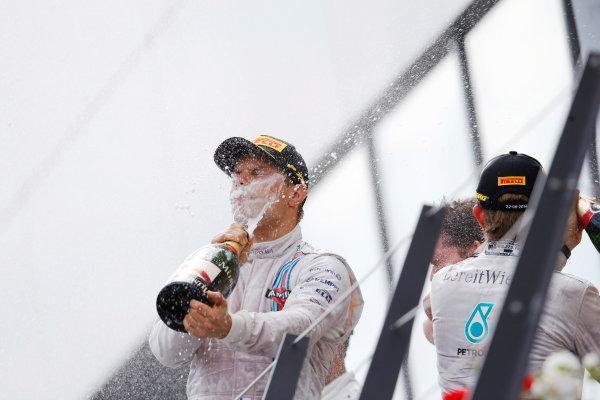 Red Bull Ring, Spielberg, Austria. Sunday 22 June 2014. Valtteri Bottas, Williams F1, 3rd Position, blasts himself with Champagne. World Copyright: Charles Coates/LAT Photographic. ref: Digital Image _J5R1825