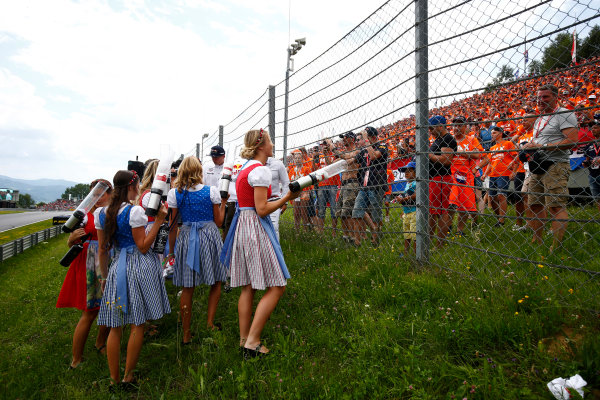 Red Bull Ring, Spielberg, Austria. Sunday 09 July 2017. Fans wait eagerly as a group of promotional girls prepare to fire T-shirts over a safety-fence. World Copyright: Andy Hone/LAT Images ref: Digital Image _ONY2371