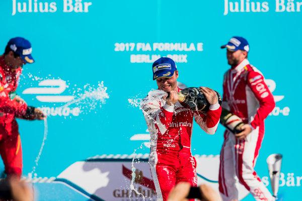 2016/2017 FIA Formula E Championship. Round 7 - Berlin ePrix, Tempelhof Airport, Berlin, Germany. Saturday 10 June 2017. Felix Rosenqvist (SWE), Mahindra Racing, Spark-Mahindra, Mahindra M3ELECTRO, sprays the chamapagne on the podium. Photo: Zak Mauger/LAT/Formula E ref: Digital Image _54I7692
