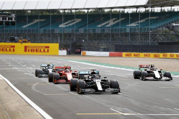 Lewis Hamilton, Mercedes F1 W11 EQ Performance, Charles Leclerc, Ferrari SF1000, Kevin Magnussen, Haas VF-20, and Valtteri Bottas, Mercedes F1 W11 EQ Performance, practice their start procedures