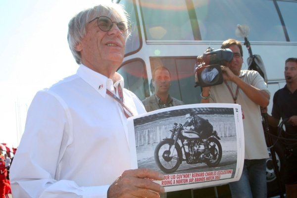 Bernie Ecclestone (GBR) F1 Supremo with a picture of himself. Formula One World Championship, Rd11, British Grand Prix, Race Day, Silverstone, England, 10 July 2005. DIGITAL IMAGE