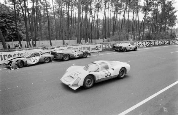 Peter Gregg / Sten Axelsson, Porsche System Engineering, Porsche 906/6 Carrera 6, passes the wreckage of Jo Schlesser /  Alan Rees' Matra Sports SARL, Matra M620 - BRM P56 (#42), Ludovico Scarfiotti / Mike Parkes' SpA Ferrari SEFAC, Ferrari 330 P3 (#20), and Georges Heligouin / Jean Rives' S.E.C. Automobiles C.D., C.D. SP66 - Peugeot 204 (#53).