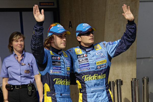 Pole sitter Fernando Alonso waves to the media with teammate Giancarlo Fisichella after clinching a front row lockout.