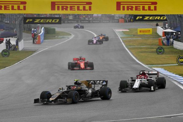 Kevin Magnussen, Haas VF-19, leads Kimi Raikkonen, Alfa Romeo Racing C38, and Sebastian Vettel, Ferrari SF90