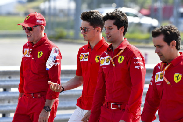 Charles Leclerc, Ferrari walks the track with his mechanics