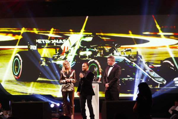 Nic Hamilto, brother of F1 World Champion Lewis Hamilton on stage to accept the British Competition Driver and International Racing Driver awards