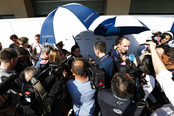 Robert Kubica, Williams Racing, and Claire Williams, Deputy Team Principal, Williams Racing, talks to the press