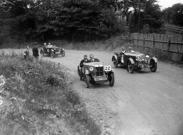 P. H. R. Saunders, MG Midget, leads D. M. Cook, Aston Martin (#63).