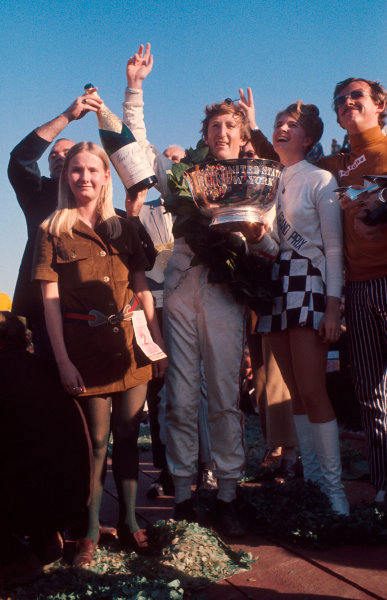1969 United States Grand Prix.Watkins Glen, New York, USA.3-5 October 1969.Jochen Rindt (Team Lotus) celebrates 1st position and his maiden Grand Prix win on the podium.Ref-69 USA 83.World Copyright - LAT Photographic