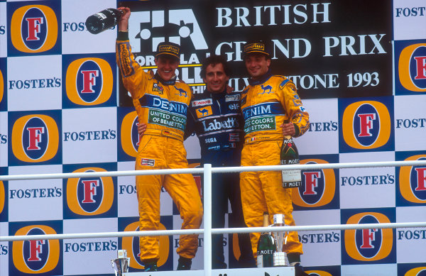 1993 British Grand Prix. Silverstone, England. 9-11 July 1993. Alain Prost (Williams Renault) 1st position with Michael Schumacher 2nd position and Riccardo Patrese, 3rd position (both Benetton B193B Ford's) on the podium. Ref-93 GB 05. World Copyright - LAT Photographic