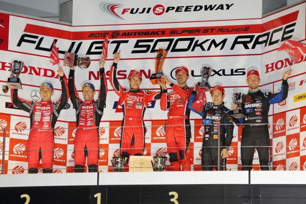 GT500 winners Yuji Tachikawa & Hiroaki Ishiura, ZENT CERUMO LEXUS LC500, celebrate on the podium, ahead of second position Tsugio Matsuda & Ronnie Quintarelli, NISSAN MOTUL AUTECH GT-R, and third place Naoki Yamamoto & Jenson Button, RAYBRIG HONDA NSX-GT
