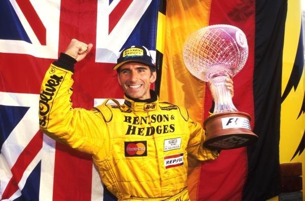 Winner Damon Hill (GBR) Jordan Mugen Honda 198 celebrates after his win Formula One World Championship, Rd 13, Belgian Grand Prix, Spa Francorchamps, Belgium, 30 August 1998