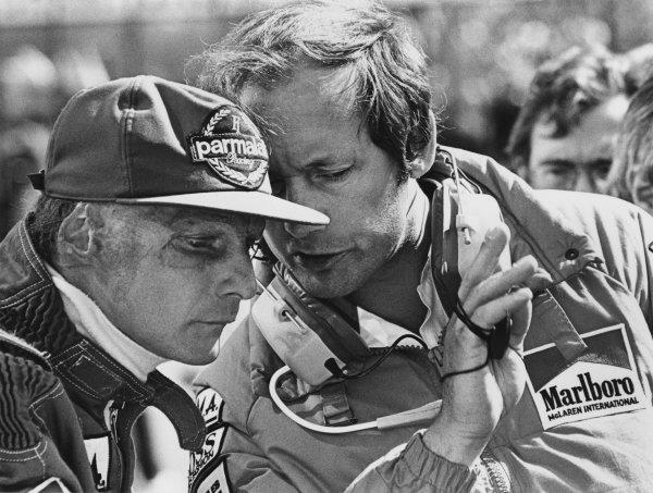 Zolder, Belgium. 27th - 29th April 1984. Niki Lauda (McLaren MP4/2 TAG Porsche), retired, with team boss, Ron Dennis, portrait. World Copyright: LAT Photographic. Ref: B/W Print.
