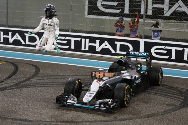 Yas Marina Circuit, Abu Dhabi, United Arab Emirates. Sunday 27 November 2016. Nico Rosberg, Mercedes F1 W07 Hybrid, celebrates as he jumps from his car after winning the World Championship. World Copyright: Glenn Dunbar/LAT Photographic ref: Digital Image _X4I5201