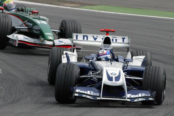 2004 European Grand Prix - Sunday Race,Nurburgring, Germany. 30th May 2004. Juan Pablo Montoya, BMW Williams FW26, aleads Mark Webber, Jaguar R5, action.World Copyright: Steve Etherington/LAT Photographic ref: Digital Image Only