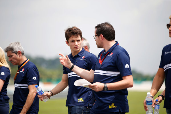 Sepang International Circuit, Sepang, Malaysia. Thursday 28 September 2017. Charles Leclerc, Sauber, conducts a track walk with colleagues. World Copyright: Zak Mauger/LAT Images  ref: Digital Image _X0W6737