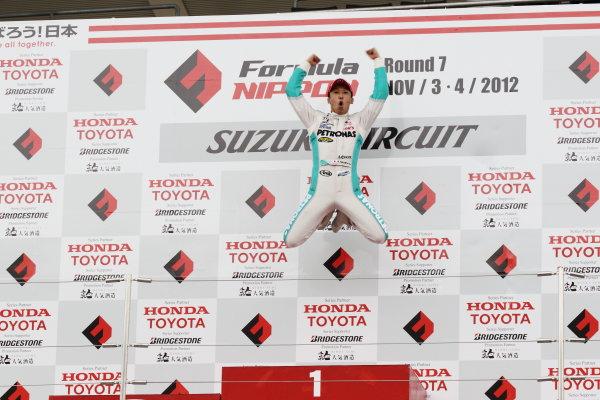 Suzuka Circuit, Japan. Rd 7 - 3rd - 4th November 2012. Race 2 Winner Kazuki Nakajima ( #2 PETRONAS TEAM TOM'S ) podium, portrait. World Copyright: Yasushi Ishihara/LAT Photographic ref: Digital Image 2012FN_Rd7_021