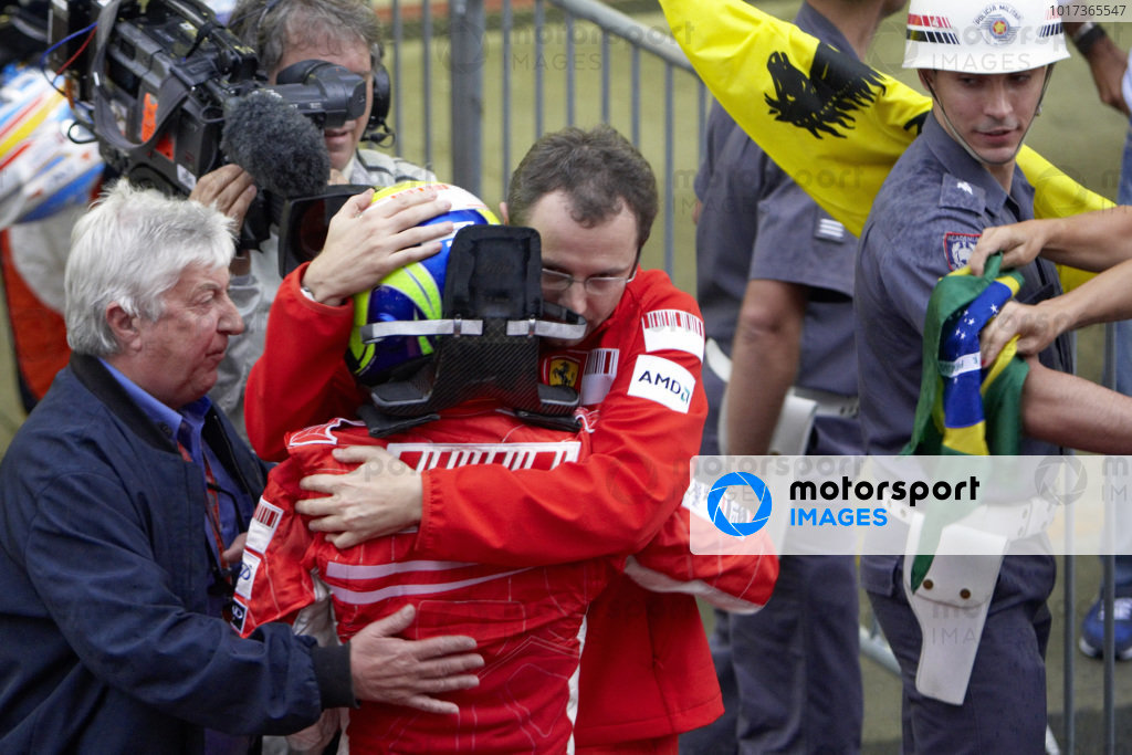 Ferrari's Stefano Domenicali and FIA race observer Herbie Blash console a Felipe Massa after the race.