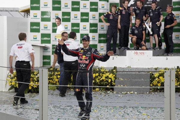 Sebastian Vettel on the podium, celebrating championship success.