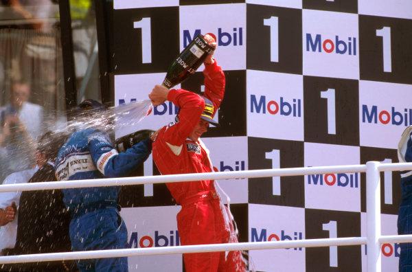 Silverstone, England.12-14 July 1996.Mika Hakkinen (McLaren Mercedes) 3rd position celebrates on the podium.Ref-96 GB 06.World Copyright - LAT Photographic