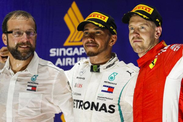 Lewis Hamilton, Mercedes AMG F1, 1st position, sand Sebastian Vettel, Ferrari, 3rd position, on the podium