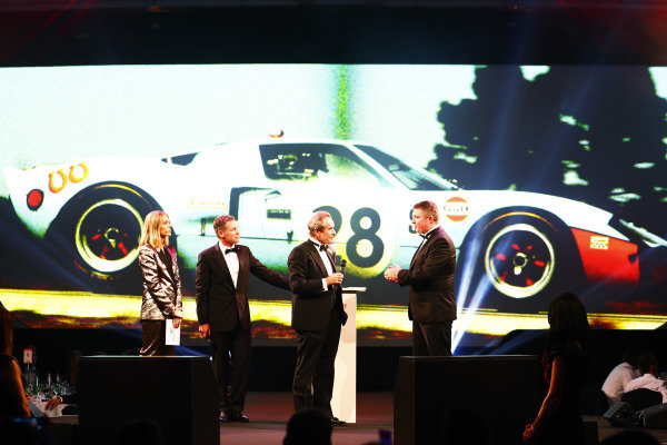 Jacky Ickx receives a Gregor Grant Award on stage