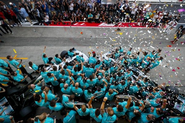The Mercedes team celebrates victory in the race and the Constructors championship