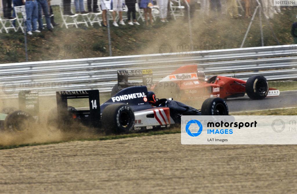 J J Lehto, Dallara BMS-191 Judd, passes, as Olivier Grouillard, Fondmetal Fomet-1 Ford, and Bertrand Gachot, Jordan 191 Ford, go off into the gravel.