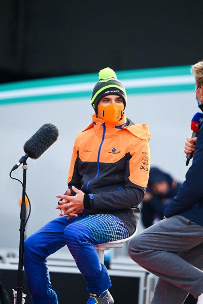 Lando Norris, McLaren, is interviewed by Nico Rosberg for Sky Sports F1