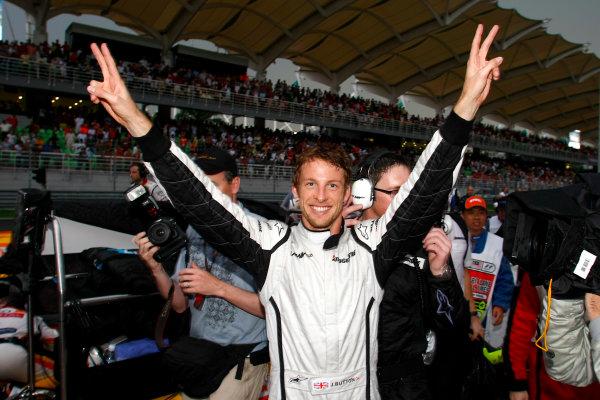 Sepang, Kuala Lumpur, Malaysia5th April 2009Jenson Button, Brawn GP BGP001 Mercedes celebrates in the pit lane after winning the race. Portrait.World Copyright: Charles Coates/LAT Photographicref: Digital Image _26Y8911