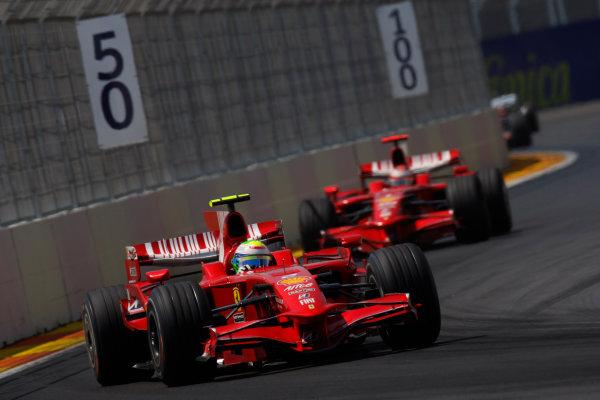 Valencia Street Circuit, Valencia, Spain24th August 2008Felipe Massa, Ferrari F2008, 1st position, leads Kimi Raikkonen, Ferrari F2008, retired. Action. World Copyright: Glenn Dunbar/LAT Photographicref: Digital Image _O9T9300