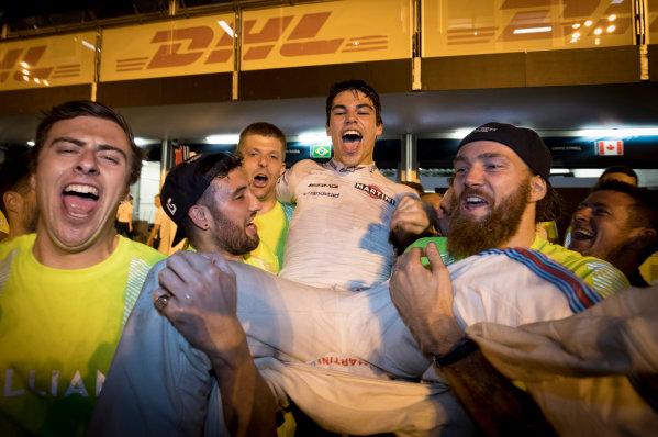 Baku City Circuit, Baku, Azerbaijan. Sunday 25 June 2017. Lance Stroll, Williams Martini Racing, 3rd Position, celebrates with his team. World Copyright: Glenn Dunbar/LAT Images ref: Digital Image _31I4074