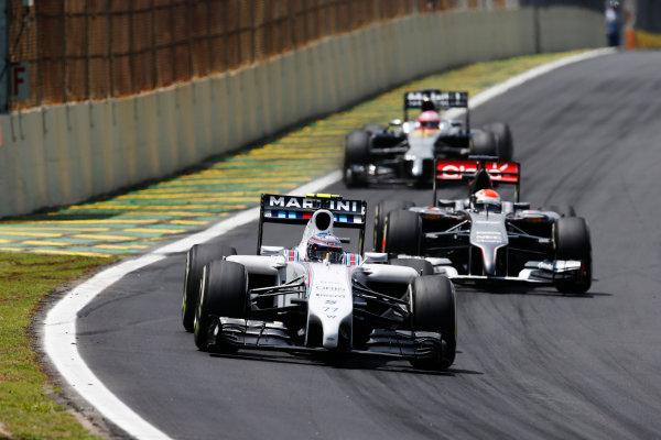Interlagos, Sao Paulo, Brazil. Sunday 9 November 2014. Valtteri Bottas, Williams FW36 Mercedes, leads Adrian Sutil, Sauber C33 Ferrari, and Jenson Button, McLaren MP4-29 Mercedes. World Copyright: Glenn Dunbar/LAT Photographic. ref: Digital Image _W2Q2452