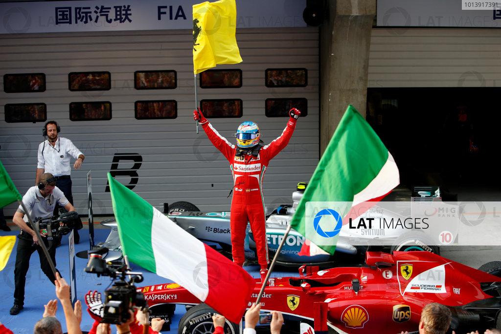 Shanghai International Circuit, Shanghai, China Sunday 14th April 2013 Fernando Alonso, Ferrari, 1st position, celebrates in Parc Ferme. World Copyright: Glenn Dunbar/LAT Photographic ref: Digital Image _89P8857