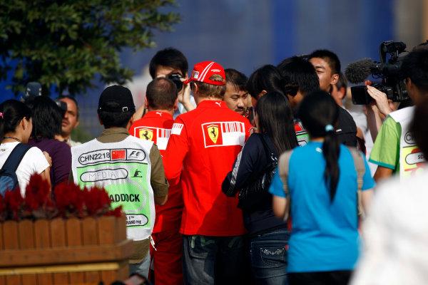 Shanghai International Circuit, Shanghai, China16th October 2008Chinese race fans follow Kimi Raikkonen, Ferrari F2008. Portrait. World Copyright: Andrew Ferraro / LAT Photographicref: Digital Image _H0Y0176
