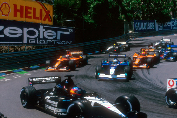 Monte Carlo, Monaco. 29th May 2001. David Coulthard battles from the back after losing his pole position due to failure of the McLaren launch control.World Copyright: Martyn Elford/LAT Photographic ref: 35mm Priority Image 01MON16