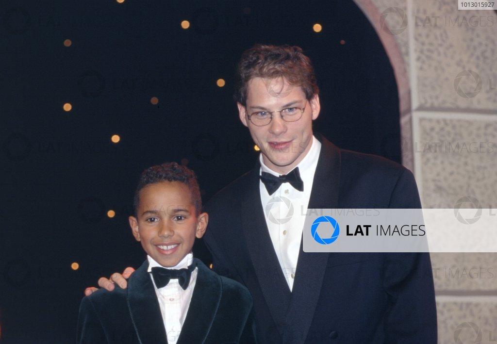 1995 Autosport Awards. Grosvenor House Hotel, Park Lane, London. 3rd December 1995. Lewis Hamilton and Jacques Villeneuve, portrait. World Copyright: Bloxham/LAT Photographic Ref: Colour Transparency.